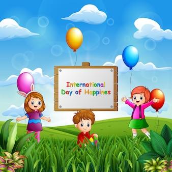 Międzynarodowy dzień szczęścia w tle ze szczęśliwymi dziećmi