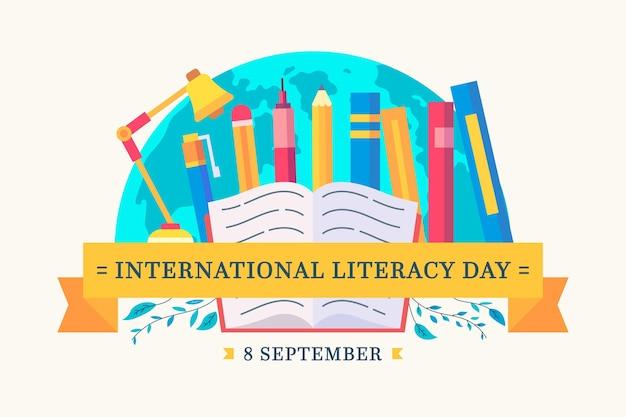 Międzynarodowy dzień umiejętności czytania i pisania z książkami i ołówkami