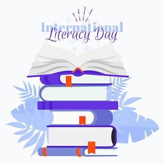 Międzynarodowy dzień umiejętności czytania i pisania ze stosem książek
