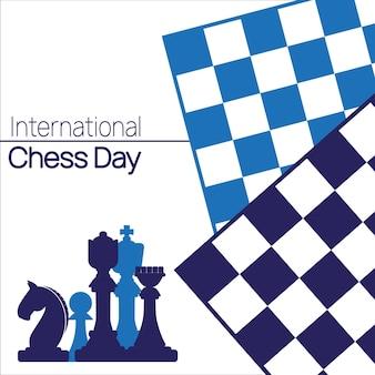 Międzynarodowy napis z dnia szachowego z figurami szachowymi i plakatem z rysunkami dwóch szachownic