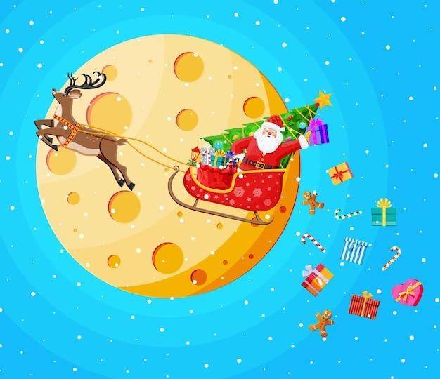 Mikołaj na saniach pełnych prezentów i reniferów