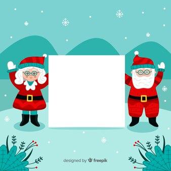 Mikołaj para trzymając pusty znak