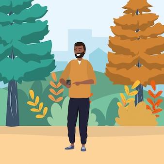 Millennial używa smartfona do przeglądania przyrody