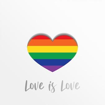 Miłość jest miłością. lgbt duma z kolorowym sercem w stylu rzemiosła papierowego