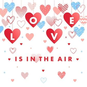 Miłość unosi się w powietrzu - kartka okolicznościowa z różnymi sercami.