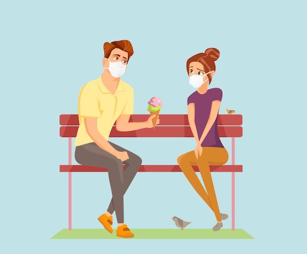 Miłość w czasach pandemii. para na randkę i za pomocą masek chirurgicznych.