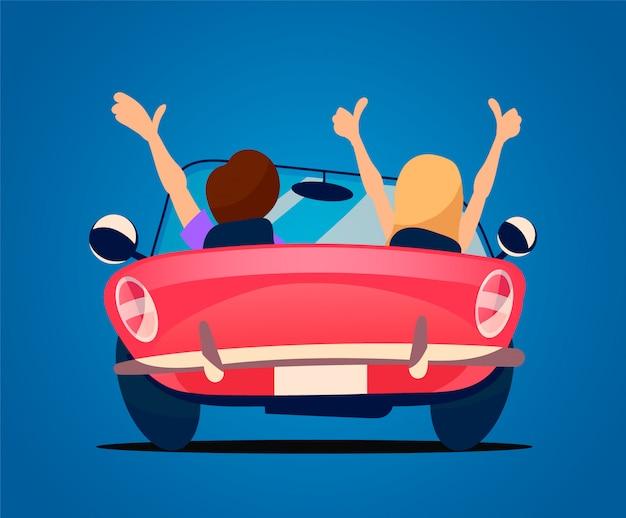 Miłośnicy jeżdżą w czerwonym kabriolecie.