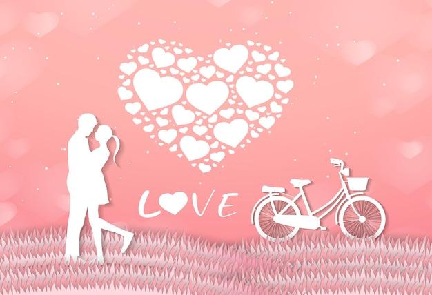 Miłośnicy miłości i walentynek stoją na łąkach i papierowy balon w kształcie serca