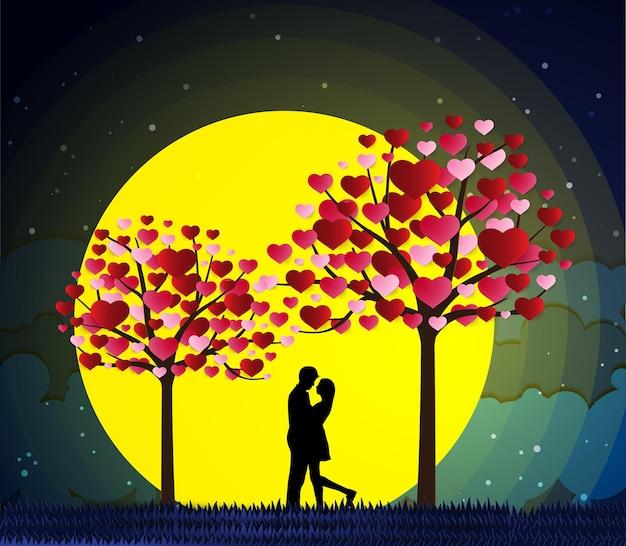 Miłośnicy miłości i walentynek stoją na łąkach i papierowym sercu artystycznym