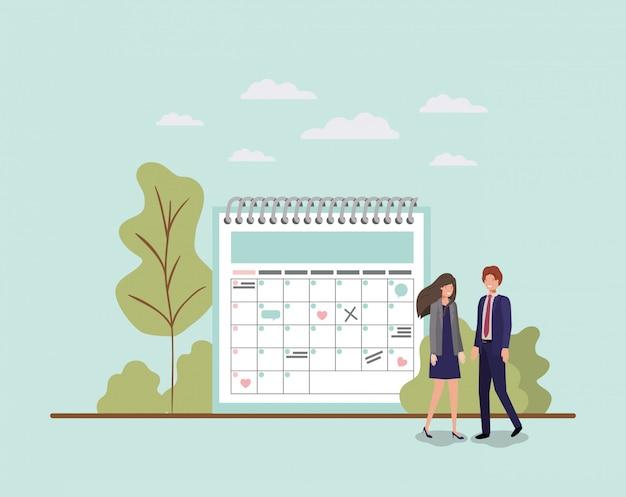Mini ludzie z przypomnieniem kalendarza