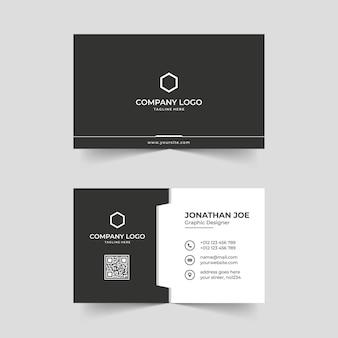 Minimalistyczny czarno-biały nowoczesny szablon wizytówki premium wektorów