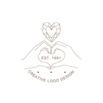 Minimalne dłonie z logo dłoni tworzące symbol serca z kryształem