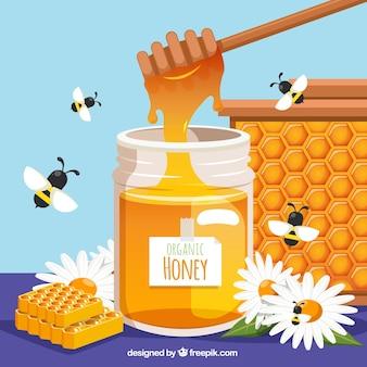 Miód organiczny i pszczoły wokół