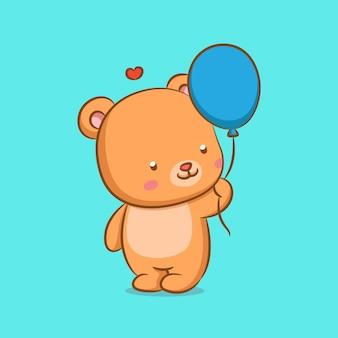 Miś lalka trzyma niebieskie balony