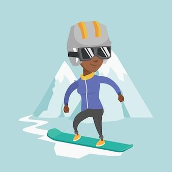 Młoda afroamerykańska kobieta na snowboardzie.