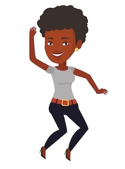 Młoda afroamerykańska kobieta skacze.