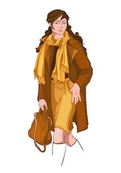 Młoda brunetka kobieta ubrana w żółte i brązowe jesienne ubrania