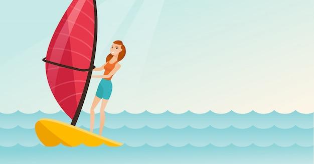 Młoda caucasian kobieta windsurfing w morzu