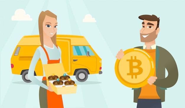 Młoda caucasian piekarz oferuje zapłatę bitcoin.