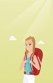 Młoda caucasian podróżnicza kobieta z plecakiem.