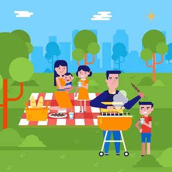 Młoda caucasian rodzina ma pinkin w parku