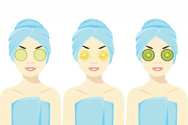 Młoda dama stosuje ogórek, cytrynę i kiwi na jej oczach