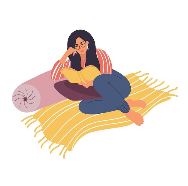 Młoda dziewczyna siedzi na podłodze i czyta książkę. ilustracja wektorowa