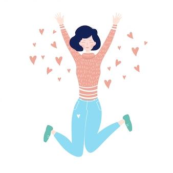 Młoda dziewczyna skacze od szczęścia. skacząca dziewczyna z sercami.