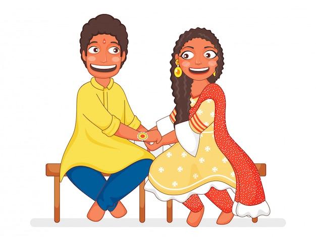 Młoda dziewczyna wiąże rakhi na nadgarstku swojego brata na obchody raksha bandhan.