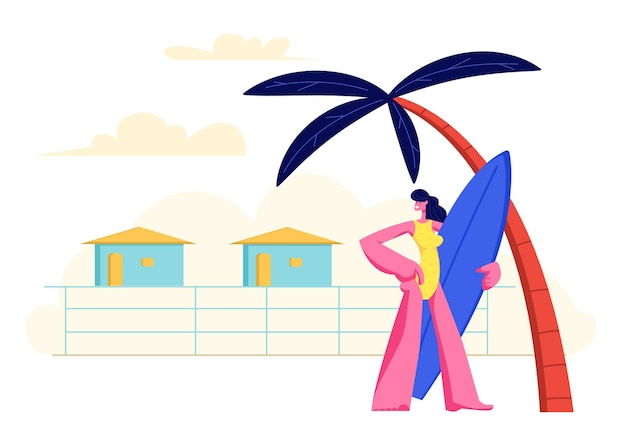 Młoda dziewczyna z deską surfingową w rękach stojących na piaszczystej plaży pod palmą na tle ośrodka lodges