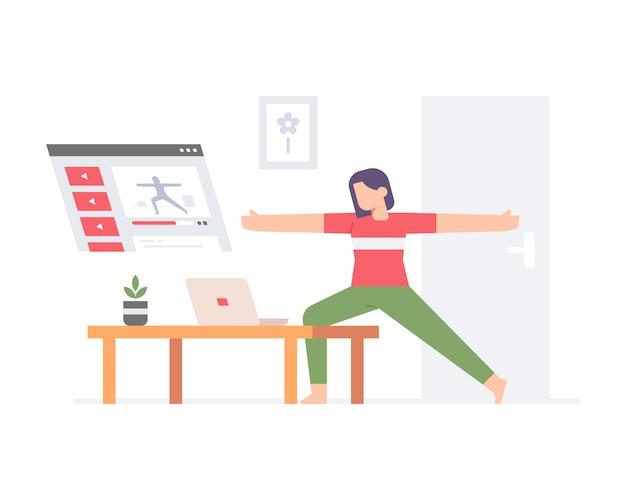 Młoda kobieta ćwiczy jogę online za pośrednictwem laptopa