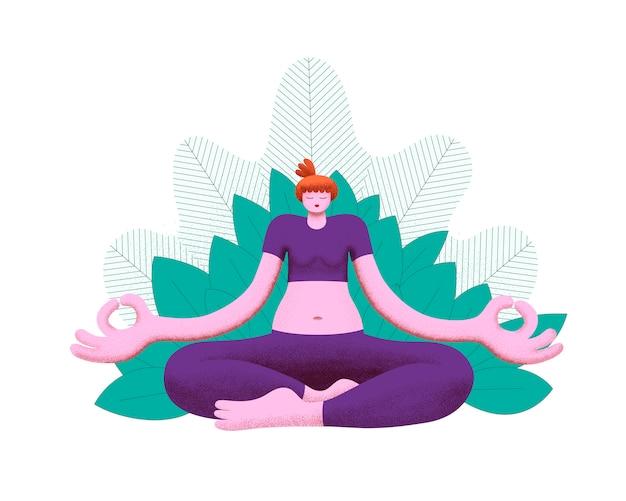 Młoda kobieta ćwiczy medytację jogi z nogami skrzyżowanymi wśród roślinności