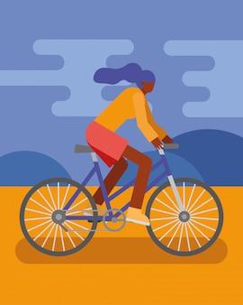 Młoda kobieta jazda na rowerze uprawiania charakteru działalności