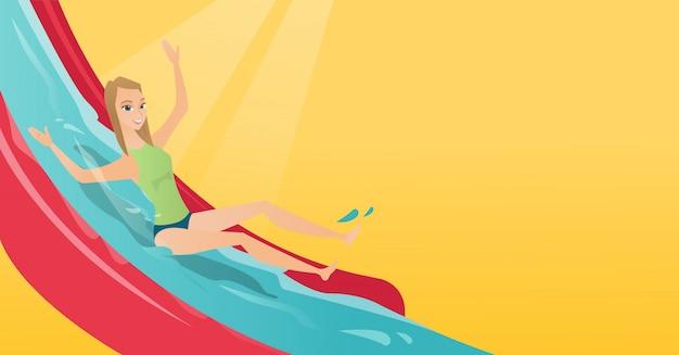 Młoda kobieta kaukaski jazda w dół zjeżdżalnia wodna