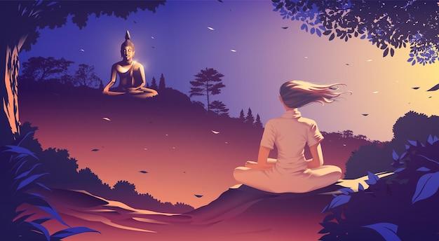 Młoda kobieta medytuje na szczycie góry