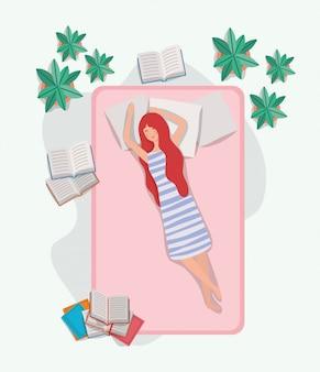 Młoda kobieta relaksuje w materac w sypialni