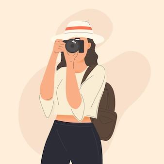 Młoda kobieta robi zdjęcie z ilustracją aparatu