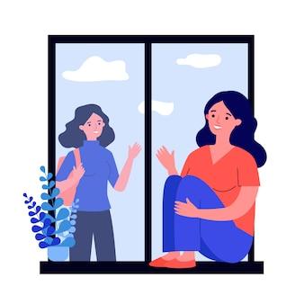 Młoda kobieta siedzi na oknie i macha do przyjaciela
