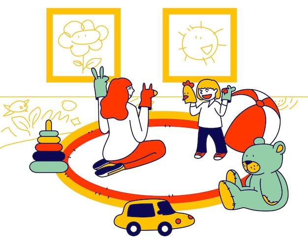 Młoda kobieta siedzi na podłodze, grając w przedstawienie kukiełkowe z małym maluchem umieścić zabawki na rękach. płaskie ilustracja kreskówka