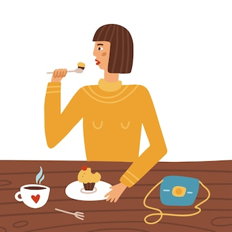 Młoda kobieta siedzi przy stoliku w kawiarni jedząc babeczkę i pijąc kawę kobieca postać jedząca lunch...