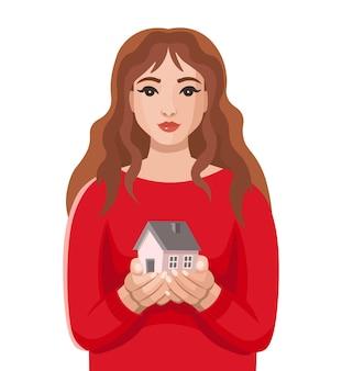 Młoda kobieta trzyma dom w rękukoncepcja wynajęcia domu na zakup hipotecznego ubezpieczenia nieruchomości i