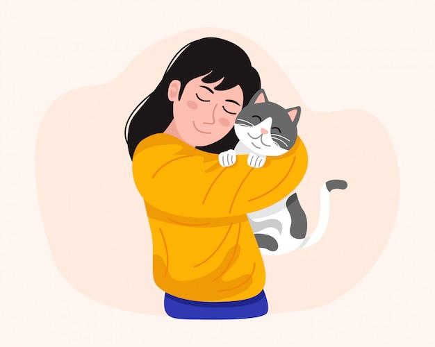 Młoda kobieta trzyma ślicznego kota. ilustracja