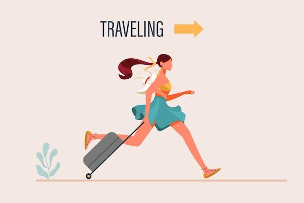 Młoda kobieta ubrana w modne ubrania chodzenie z torbą podróżną