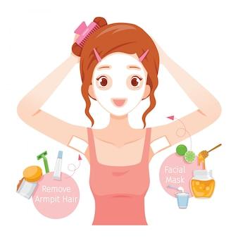 Młoda kobieta woskuje jej włosy pod pachami i maskę twarz