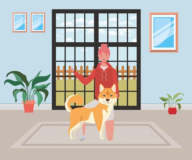 Młoda kobieta z ślicznym psem w domowym pokoju