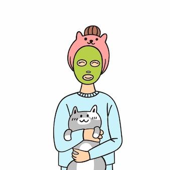 Młoda kobieta z zieloną maską do pielęgnacji skóry, przytulająca się ze słodkim kotem