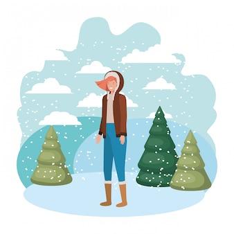 Młoda kobieta z zimowymi ubraniami