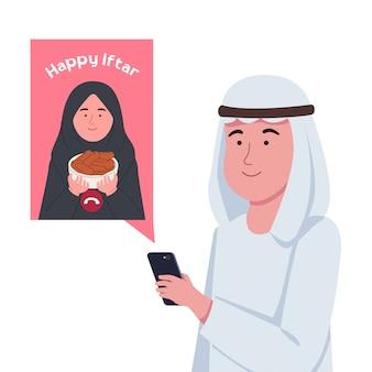Młoda para arabska rozmowa wideo z pozdrowieniami iftar