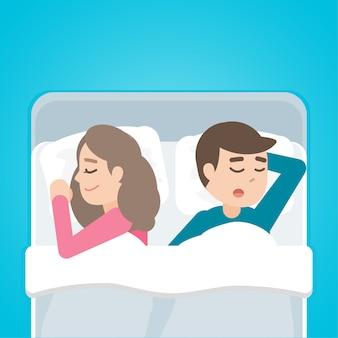 Młoda para mężczyzna i kobieta śpi w łóżku razem