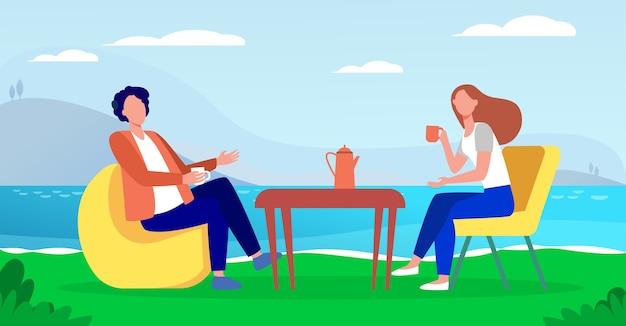Młoda para picia kawy na brzegu jeziora. para mężczyzna i kobieta randki płaska ilustracja wektorowa. romantyczne spotkanie, romans, wakacje